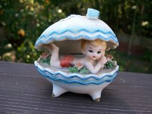 GIRL IN A SHELL FIGURINE OR NICK NACK