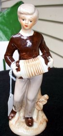 FIGURINE OF ACCORDIAN PLAYER
