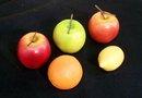 FIVE PIECES OF DECORATIVE FRUIT
