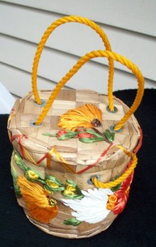 DECORATED WOVEN BASKET WITH LID AND HANDLES