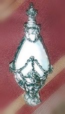 MOTHER OF PEARL PIN WITH A FIGURE AND A FACE