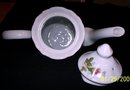 TEA OR DEMITASSE POT WITH LID, CUP AND SIX SAUCERS