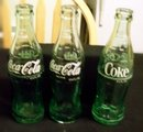 THREE 6 1/2 OZ. COCA-COLA BOTTLES