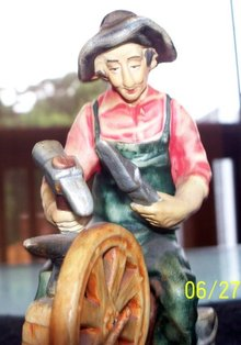 BLACKSMITH FIGURINE - PORTUGAL - PRICE REDUCED -  SHIPS FREE WITHIN U.S.A..