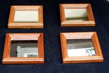 SET OF FOUR SMALL WOOD FRAMED MIRRORS