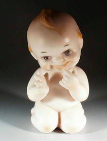 KEWPIE BISQUE DOLL
