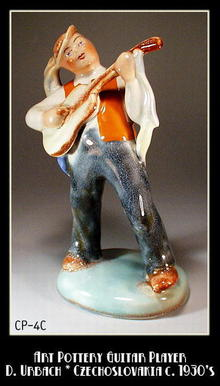 CZECH POTTERY LARGE GUITAR PLAYER D. URBACH