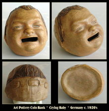 ANTIQUE GERMAN CRYING BABY FACE POTTERY COIN