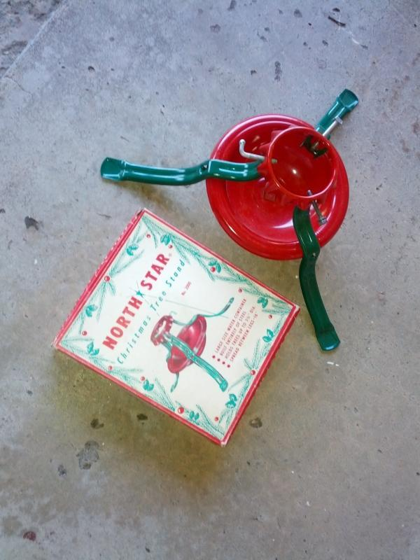 1950's red green steel christmas tree stand holiday fixture north star original cardboard box usa manufactured product