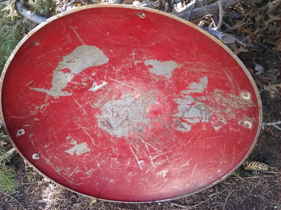 steel  round disc style sled 1950's snow hill sliding equipment childrens winter toy old red painted wall decoration retro game room ornament