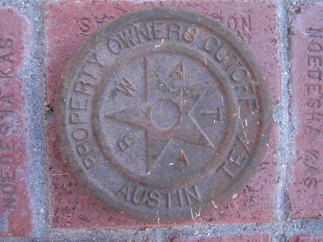 AUSTIN  TEXAS CAST IRON WATER CAP PROPERTY MARKER DISC