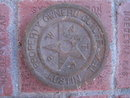 AUSTIN  TEXAS CAST IRON WATER CAP PROPERTY MARKER DISC