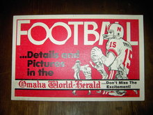 FOOTBALL SIGN OMAHA NEBRASKA WORLD HERALD NEWSPAPER BANNER RED WHITE CARDBOARD