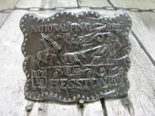 HESSTON NATIONAL FINALS RODEO BELT BUCKLE 1987 COWBOY WESTERN WEAR ACCESSORY AWARD DESIGN MEDALS NOBLE OKLAHOMA