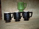 UNITED STATES U S PUMP VERTICAL MOTORS MUG FOOTED COFFEE CUP BLACK GREEN GLAZE ADVERTISING UTENSIL