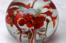 Pretty Hand Blown Art Glass Paperweight.  Flowers with center bubble