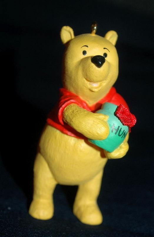 set of 4 1991 Winnie the Pooh Collection Series Hallmark Holiday Ornaments by Artist: Bob Siedler..