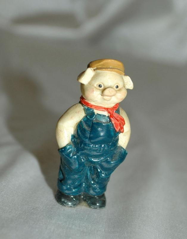 Small Overall Wearing Pig Figurine
