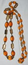 Faceted Amber Glass and Engraved Brass Necklace. Very Old