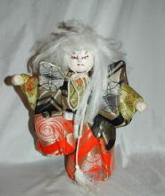 Doll of Kabuki Theatre actor as White Lion  with one knee raised