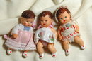 3 miniature jointed rubber baby dolls