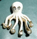 Octopus Pin/ Rhinestone eyes holding fauxpearls