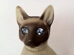 Siamese Cat with blue rhinestone eyes Perfume Bottle by Avon Moonwind 3/4 full