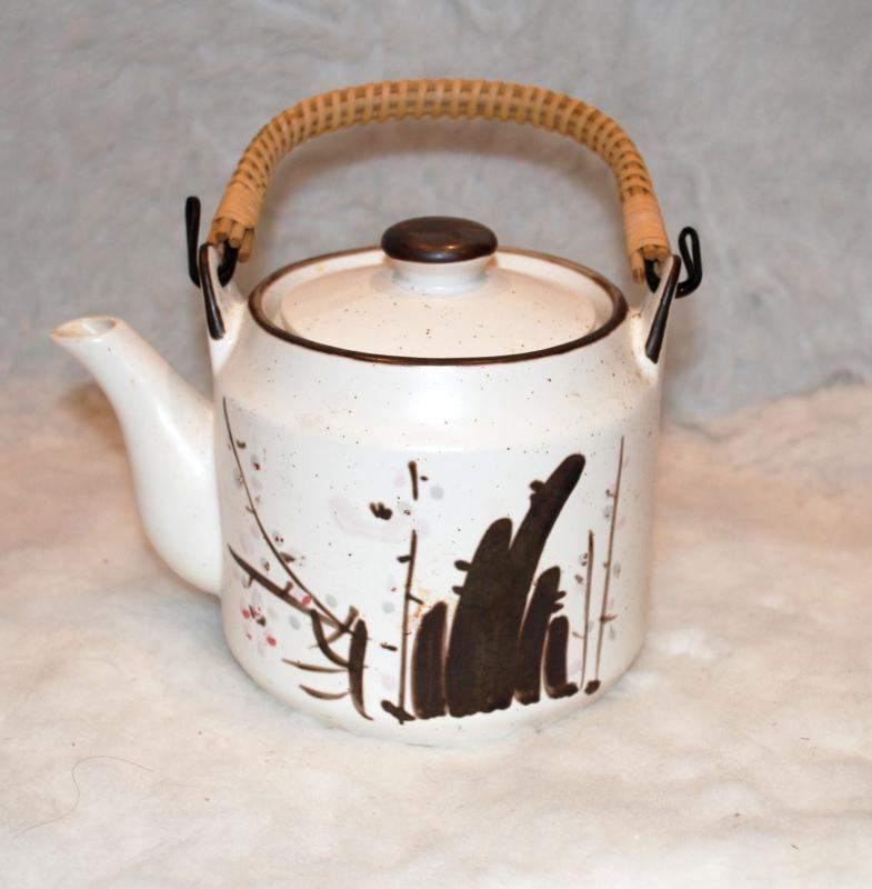 Japanese Stoneware Teapot austere brown decoration on white.