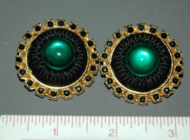 Big   clip on earrings by Carol Dauplaise
