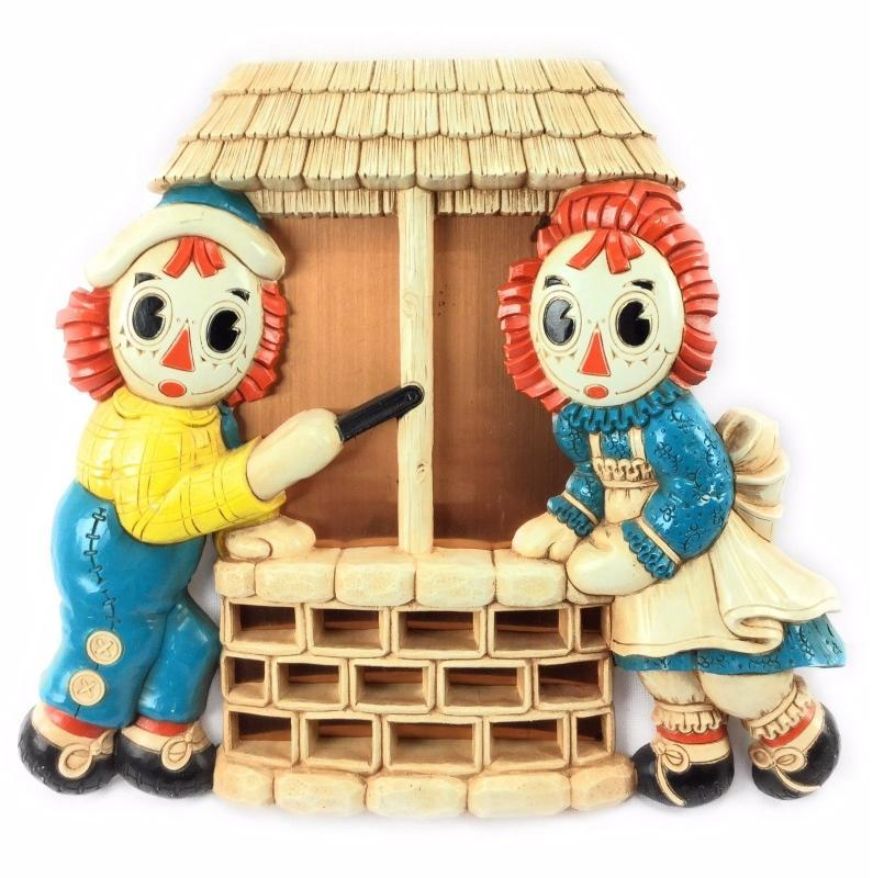 1977 BOBBS-MERRILL CO. RAGGEDY ANN and ANDY copper mirror/ well wall plaque
