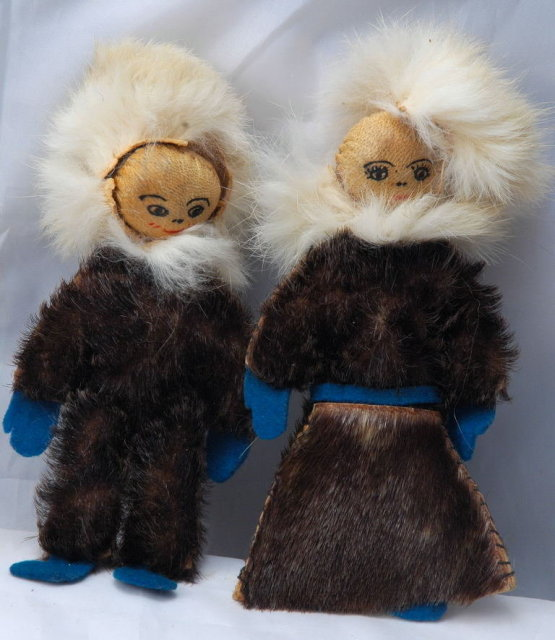 Pair of Eskimo Dolls of Seal Skin with hand painted leather faces.