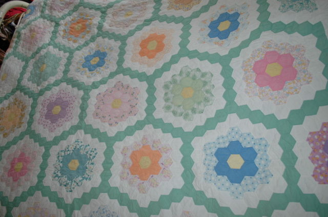 Double ring grandmother's garden hexagon quilt.
