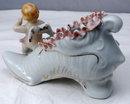Wales Porcelain Boy Angel On Flowered Shoe