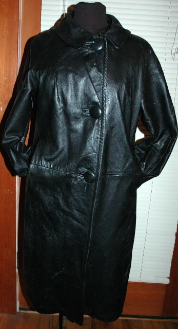 Vintage Black Leather Coat with zip in faux fur lining.