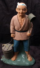 Vintage Norcrest Oriental Figurine  Vintage Norcrest Oriental Figurine carrying a bucket and ladle