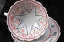 Porcelain Tea Cup  and Saucer with Miscellaneous Symbols. * PRICED REDUCED! **
